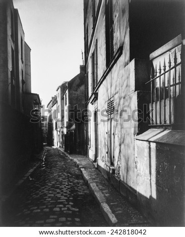 Narrow street, Rue St. Rustique, in Paris, France by Atget, Eugene, (1857-1927). Atget photographed Paris and its people with a large-format wooden bellows camera from the 1890s through the 1920s.