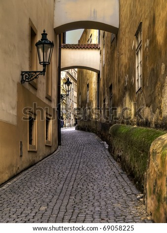 narrow street with archway in Prague, Czech - stock photo