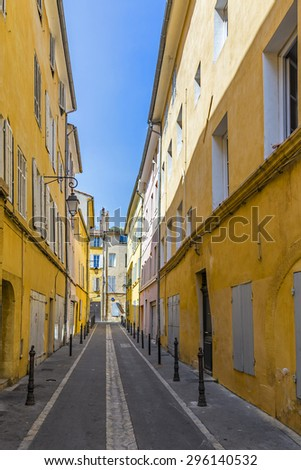 narrow street with old typical houses in Aix en Provence - stock photo