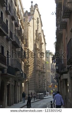 Narrow streets and alleys in the El Raval, a district of the old part of Barcelona. The quarter El Raval is the most multicultural in Barcelona  - stock photo