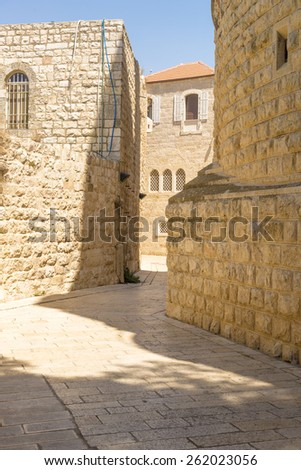narrow streets of old Jerusalem. Stone houses and arches - stock photo