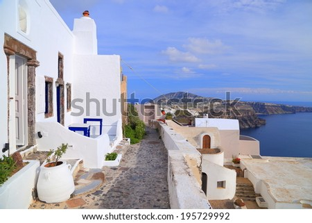 Narrow streets with white buildings on the island of Santorini, Greece - stock photo
