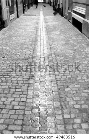 Narrow, wet cobbled street