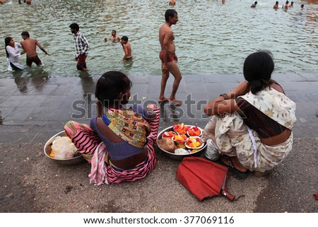 NASHIK - SEP 14:Unidentified sellers looks for customers during the event Kumbh Mela on September 14, 2015 in Nashik, India.Kumbhmela is a Hindu religious event gathered by millions - stock photo