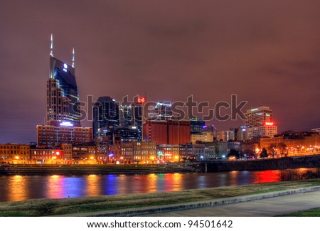 NASHVILLE – JANUARY 18: The skyline of Nashville, Tennessee at night, January 18, 2012. Nashville is the capital of the U.S. state of Tennessee. - stock photo