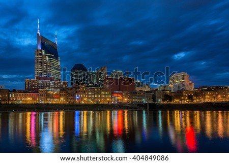 Nashville Tennessee skyline at twilight reflects on Cumberland River