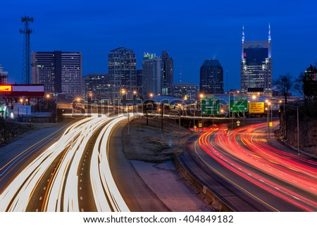 Nashville Tennessee skyline at twilight with interstate traffic