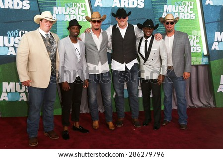 NASHVILLE, TN-JUN 10: NFL player JJ Watt (C) attends the 2015 CMT Music Awards at the Bridgestone Arena on June 10, 2015 in Nashville, Tennessee. - stock photo