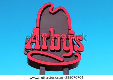 NASHVILLE, TN-JUNE, 2015:  Arby's sign set against blue sky.  Arby's Restaurant Group, Inc. is the second largest quick-service sandwich chain in the U.S. with more than 3,400 restaurants system wide. - stock photo