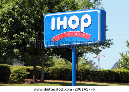NASHVILLE, TN-JUNE, 2015:  IHOP sign.  IHOP is short for International House of Pancakes and is an American chain specializing in pancakes and other breakfast treats. - stock photo