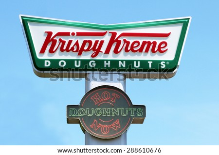 """NASHVILLE, TN-JUNE, 2015: Sign for Krispy Kreme Doughnuts with the """"Hot Doughnuts Now"""" neon light indicating fresh donuts are coming down the line inside the store. - stock photo"""