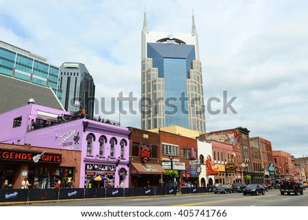NASHVILLE,TN,USA - SEP 27: AT&T Building and historical Broadway on Sep. 27, 2015 in downtown Nashville, Tennessee, USA. Lower Broadway is famous for entertainment district of country music. - stock photo