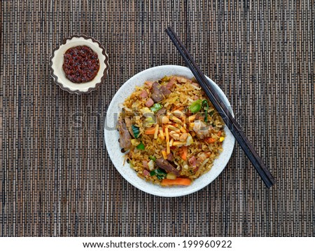 Nasi goreng with sambal oelek, Indonesian fried rice with chili paste - stock photo