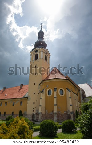 NASICE, CROATIA - May 24, 2014: Franciscan church of St. Antun Padovanski in Nasice, Croatia. The church adjoining the monastery was rebuilt and extended in the Baroque style between 1719 and 1763.