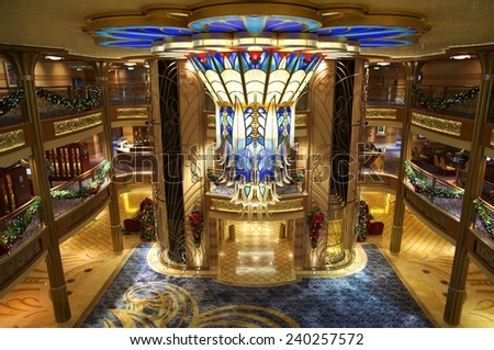 NASSAU, BAHAMAS, DECEMBER 4, 2014: Main lobby of the Disney Cruise Dream, one of the biggest and more fun cruises that navigate the Caribbean Sea, days before Christmas. - stock photo