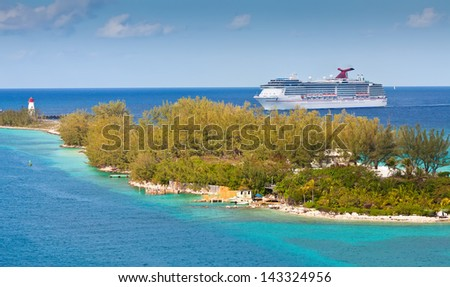 NASSAU, BAHAMAS - JAN. 13:  Carnival cruise ship enters the port of Nassau, Bahamas on Jan. 13, 2013.  The island of the Bahamas is most notably one of the most popular Caribbean cruise locations. - stock photo