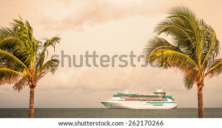 NASSAU, BAHAMAS - SEPTEMBER, 06, 2014: Royal Caribbean's ship Majesty of the Seas sails during sunset in the Port of the Bahamas on September 06, 2014 - stock photo