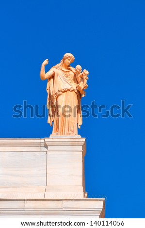 National Archaeological Museum in Athens , Greece . Sculpture on the roof-top above the entrance