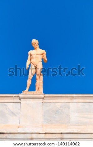 National Archaeological Museum in Athens , Greece . Sculpture on the roof-top above the entrance - stock photo