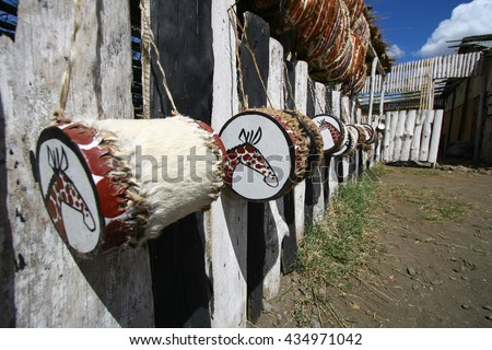 National attributes Masai warriors. Tradition hand made for sale at market in Kenya. Africa. - stock photo