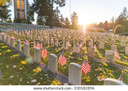 National Cemetery with a flag on Memorial day in Washington,Usa.  - stock photo