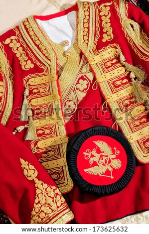 National costume of Montenegro, male hat and the upper part of the costume. Handmade costume. - stock photo