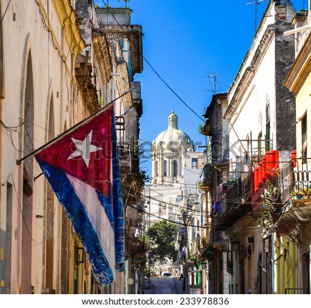National flag from cuba with view of the capitol in cuba havana - stock photo