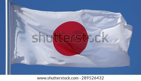 National Flag of Japan in the sun  - stock photo