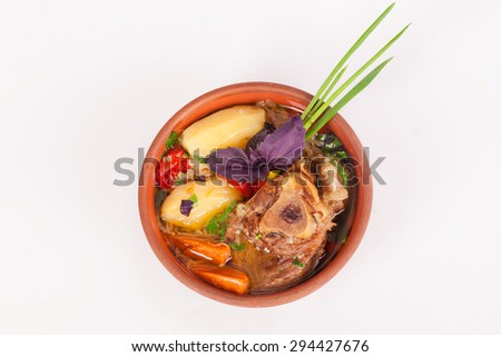 national food roast with potatoes and meat lamb beef with green onion, carrot, tomato - stock photo