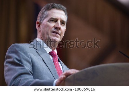 NATIONAL HARBOR, MD - MARCH 8, 2014: Heritage Foundation president Jim DeMint speaks at the Conservative Political Action Conference (CPAC). - stock photo