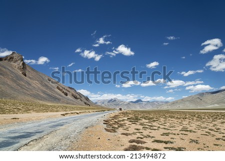 National highway among high altitude mountains - stock photo