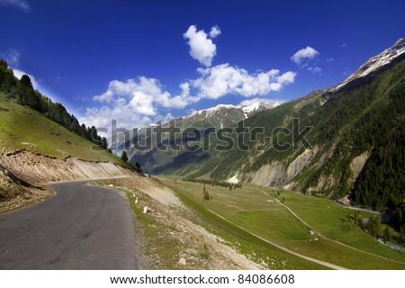 National Highway 1 from Srinagar to Leh going through the mountains with greenery all around and blue skies,ladakh, Jammu and  Kashmir, India - stock photo