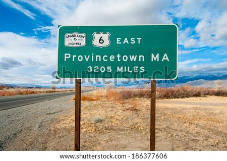 National Highway Origin Sign:  A road sign marks the western origin of The Grand Army of the Republic Highway (US Route 6) as it emerges from Bishop, CA and extends eastward to Provincetown, MA.  - stock photo