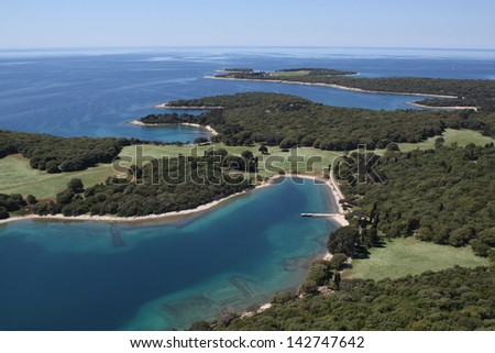 National park Brijuni  are a group of fourteen small islands in the Croatia part of the northern Adriatic Sea , bay Verige with old Roman monuments - aerial view - stock photo