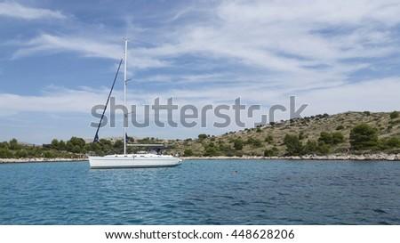 National Park Kornati islandsa and sailboat at sea in national park, Croatia - stock photo