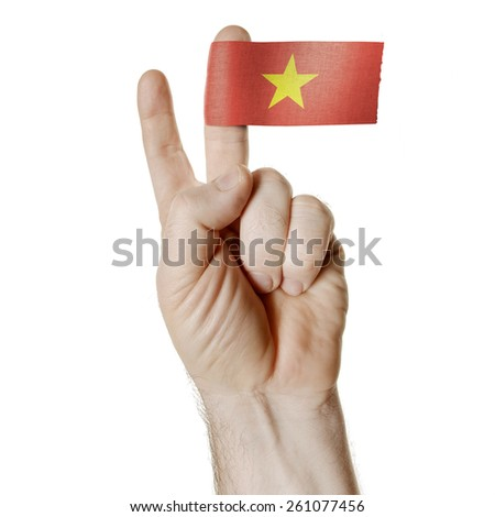 National symbol of victory: a hand with two fingers with the flag of Vietnam - stock photo