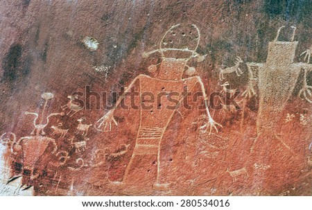 Native American Indian Fremont Petroglyphs Sandstone Mountain Capitol Reef National Park Torrey Utah  - stock photo