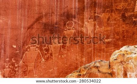 Native American Indian Fremont Petroglyphs Sandstone Mountain Capitol Reef National Park Torrey Utah  - stock photo