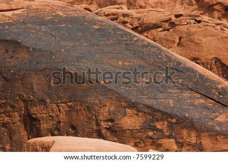 Native American petroglyph on canyon slope - Valley of fire SP - stock photo
