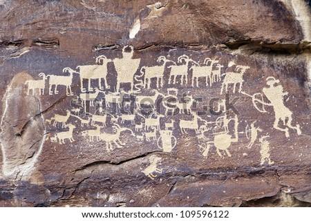 Native American Rock Art Petroglyphs - Great Hunt Panel at Nine Mile Canyon, UT - stock photo