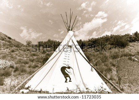 Native American teepee in old style sepia tone. - stock photo