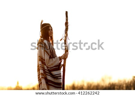 native American woman  shaman with pikestaff on background of sunset beautiful in mountains - stock photo