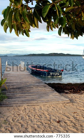 native boat by pier panama san blas 917 - stock photo