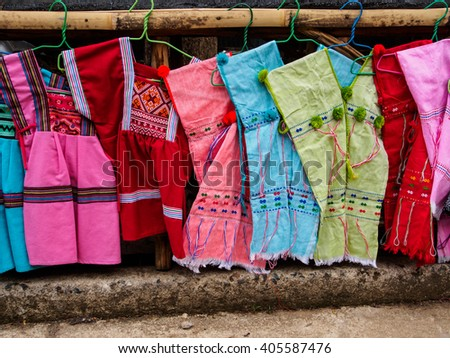 Native coat of many colors in market