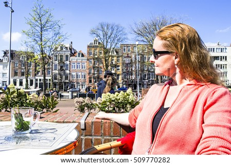 Native dutch woman drinking tea on a terrace in Amsterdam the Netherlands