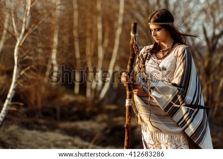 native indian american woman shaman on hill  in sunset evening mountains - stock photo