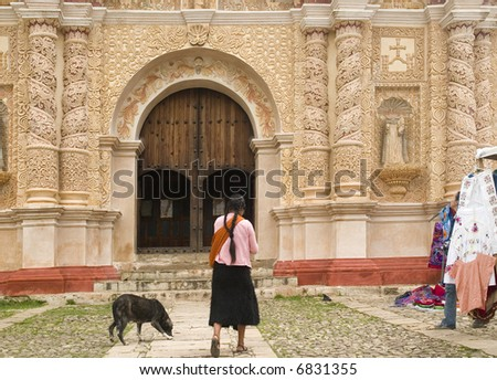 Native Mexican by Colonial Church - stock photo