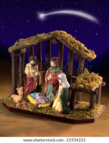 nativity over a table with starry night behind - stock photo