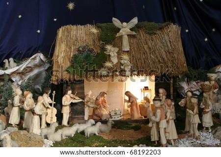 Nativity scene, creche, or crib, is a depiction of the birth of Jesus - stock photo
