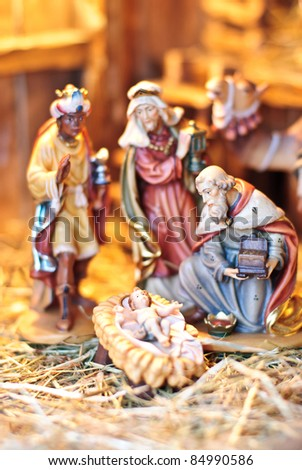 nativity scene; the three Magi at the crèche of the young Jesus Christ - stock photo